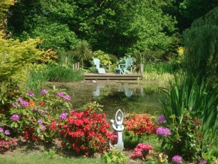 Pond and Deck at Barn House Cottages