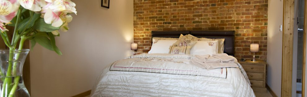 Luxury Double bedroom in the Wheatacre Hall barn complex