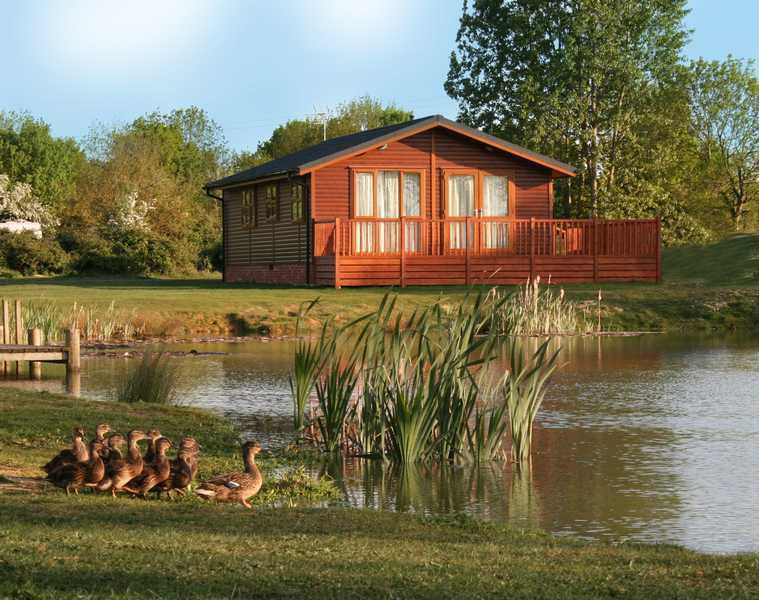 One of the luxurious lodges at Yaxham Waters in Norfolk